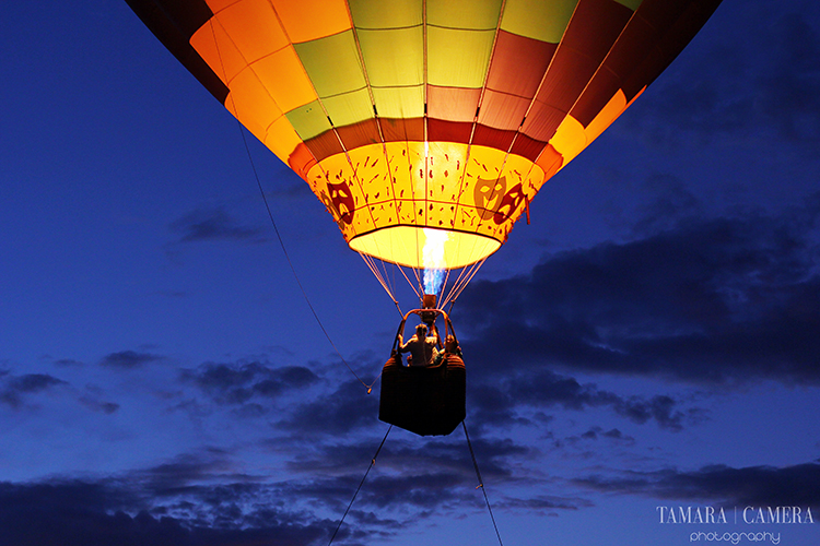 Hot air balloon against a dark sky | Learning about hue and color will help you to capture better photographs | Photography Tip