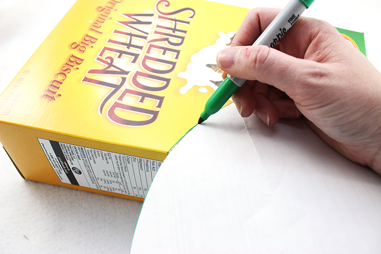 Trace a curved shape onto your cereal box, and cut.