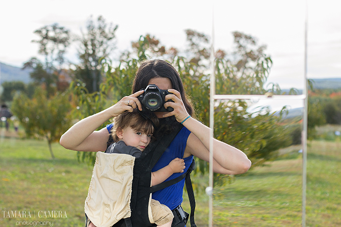Use a mirror to capture a photo of you doing what you do best - taking a picture!