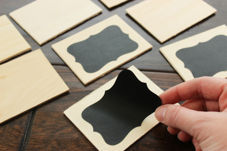 Vinyl chalkboard stickers on wood squares.