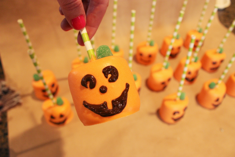 Jack-O-Lantern Marshmallow Pops make a cute and easy Halloween craft.