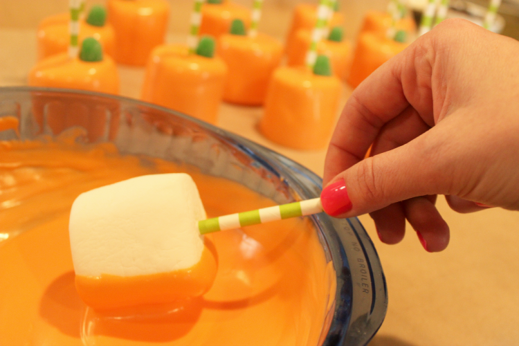 Dip marshmallows in melted orange candy.