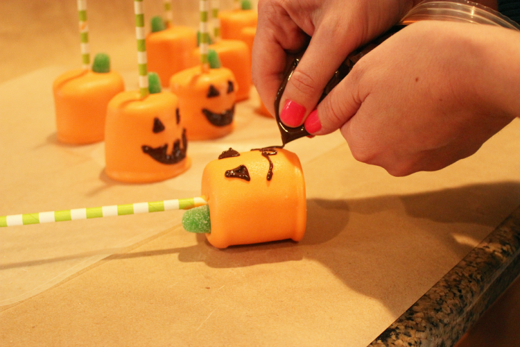 Pipe Chocolate Jack-O-Lantern Faces On Marshmallow Pops