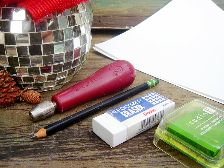Supplies needed to make your own holiday stamp.