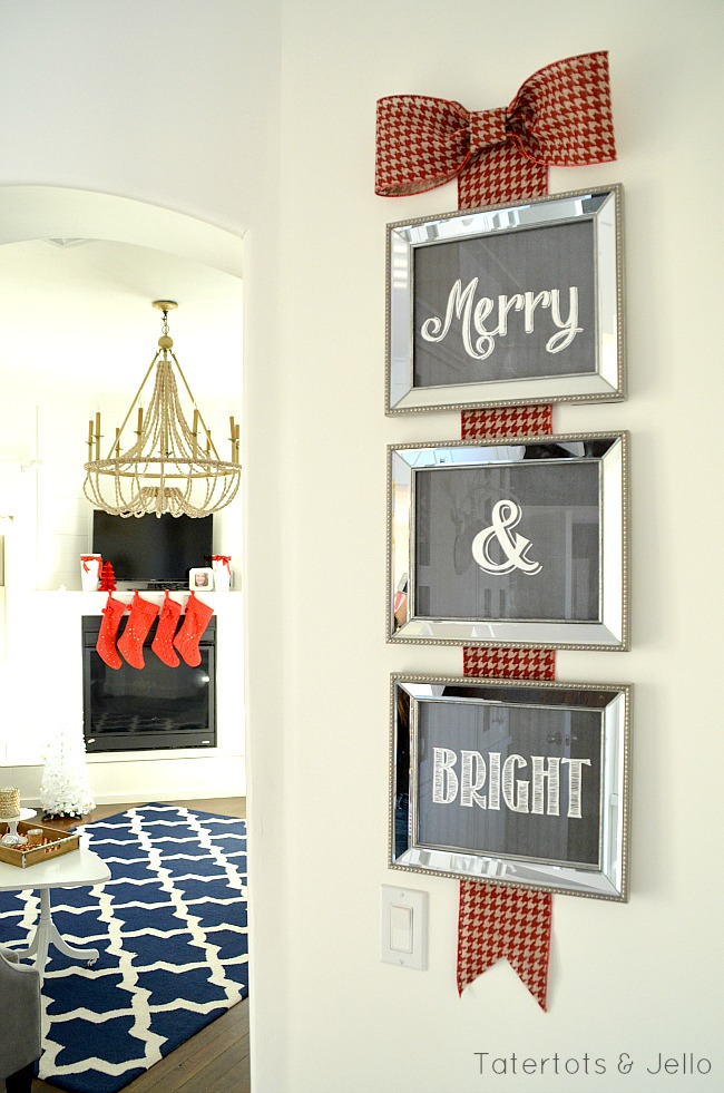 Merry and Bright Christmas sign with red stockings hanging on the mantle. Great Christmas decorating ideas.
