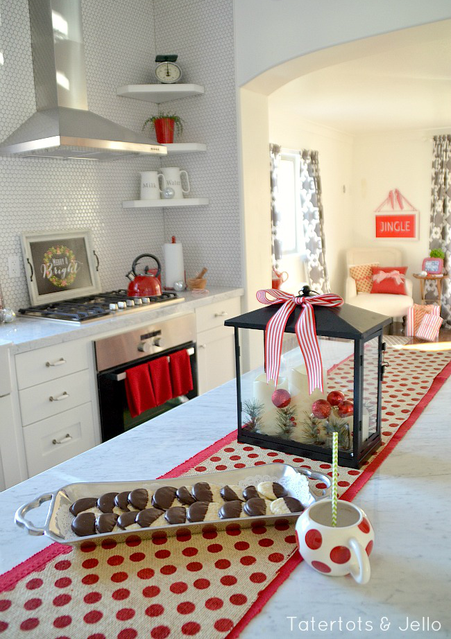 Great Christmas decorating ideas - white kitchen with touches of red for the holidays.