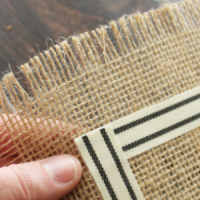 This DIY Burlap Table Runner only takes 30 minutes to make!