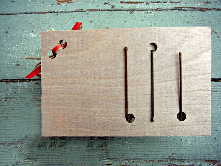 Punch holes in the birch ply wood.