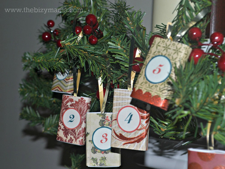 Advent Christmas decor - put your advent calendar in your Christmas mantle garland.