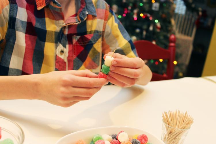 Begin layering gumdrops on toothpicks.