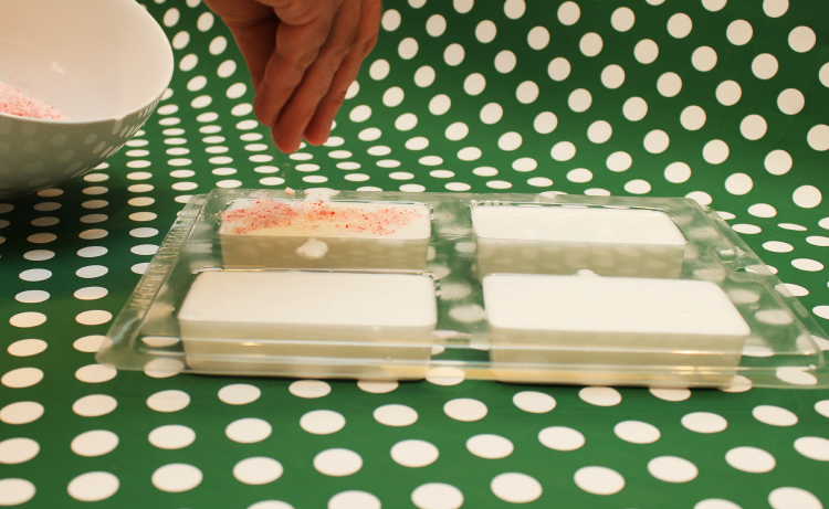 Cover the top of your soap with the candy cane pieces.