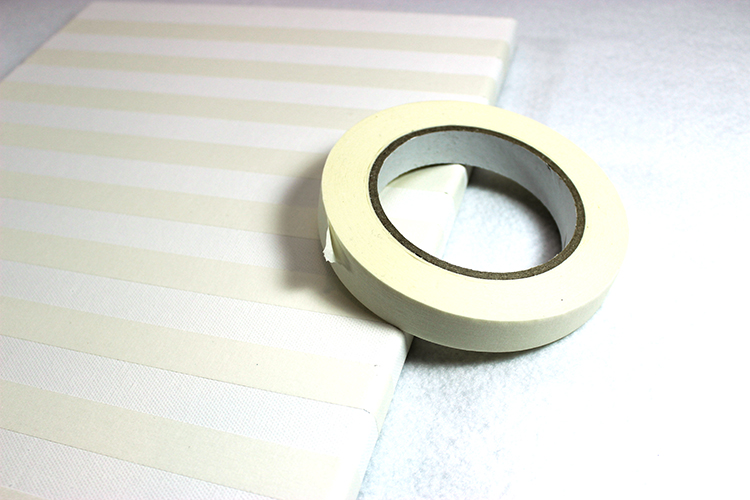 Create stripes on your canvas with masking or painters tape.