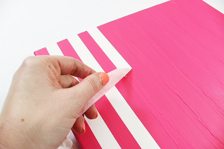 Remove the tape from your canvas once it is completely dry.