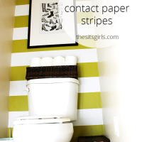 One of the best small bathroom design ideas I have seen. Use contact paper to create stripes on your wall. This is a simple and easy bathroom redo, and a great design idea for renters.