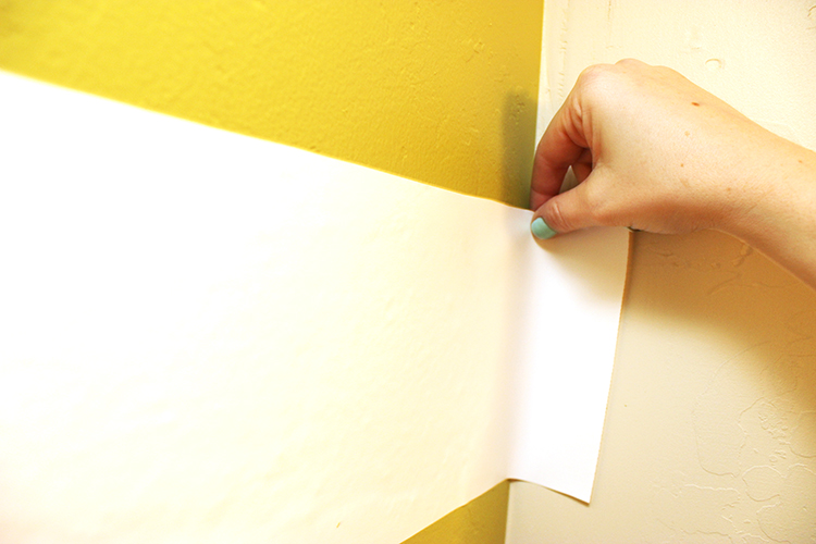 Place contact paper on the wall to create stripes without paint. Great way to decorate a small space.