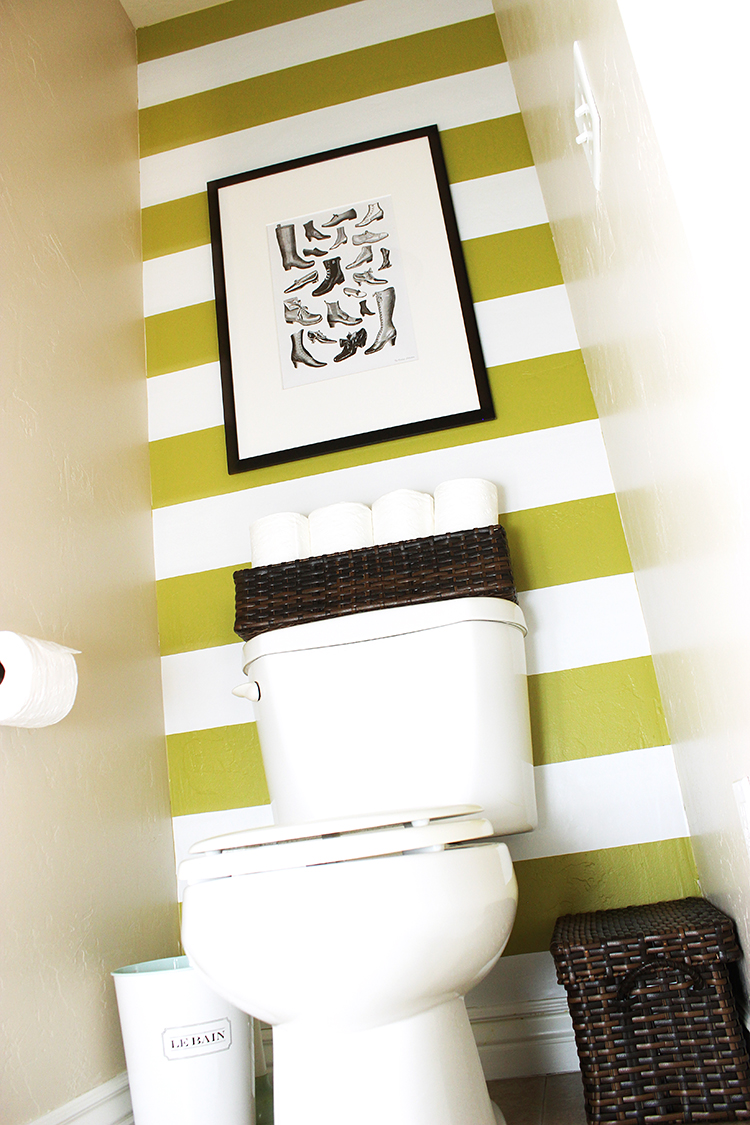 Small bathroom redo with easy stripes made with contact paper. I want to try this!