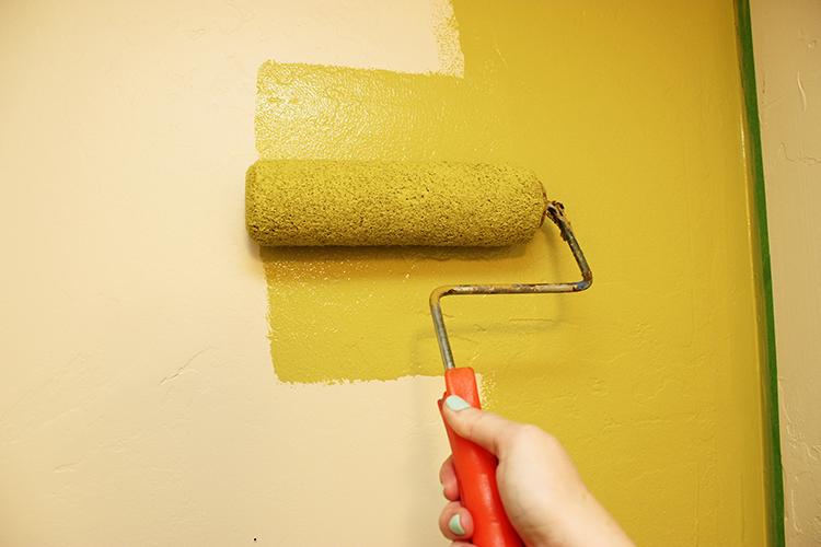 Painting a small bathroom wall split pea green.