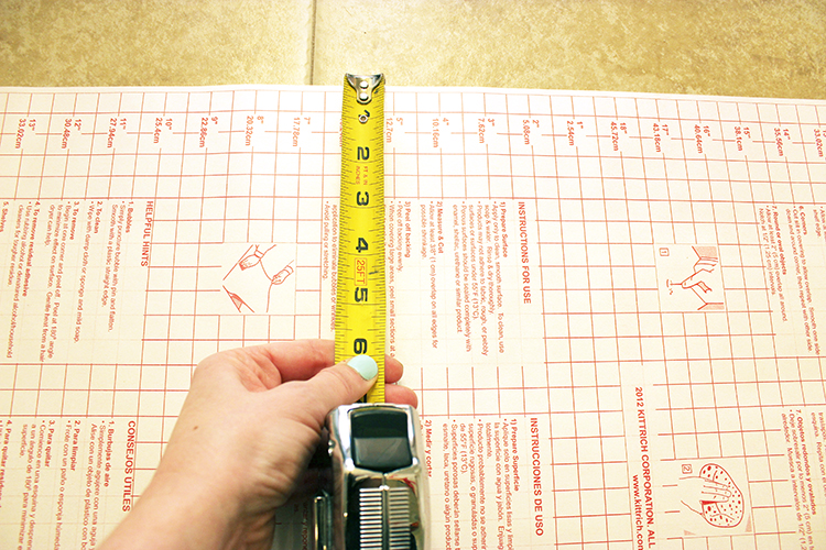 Decide how thick you want to make the stripes on your wall, and then measure and cut contact paper.