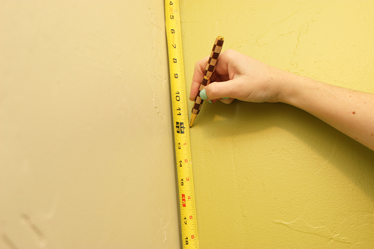 Measure your wall and plan where you want your stripes to fall. You might have to make room for an uneven wall.