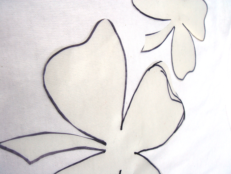 Tracie four leaf clovers onto clear contact paper.