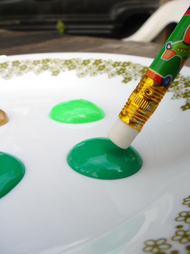 Dip your clean eraser into fabric pain to create an easy St Patrick's Day t-shirt.
