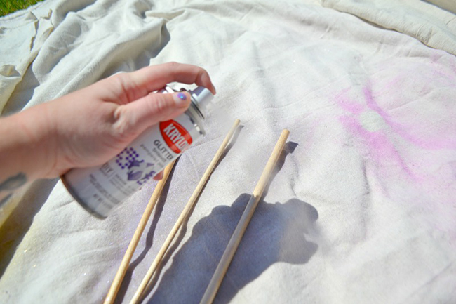 Spray paint your wooden dowels