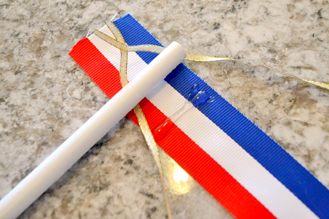 Use hot glue to attach your ribbons to the wooden dowel.