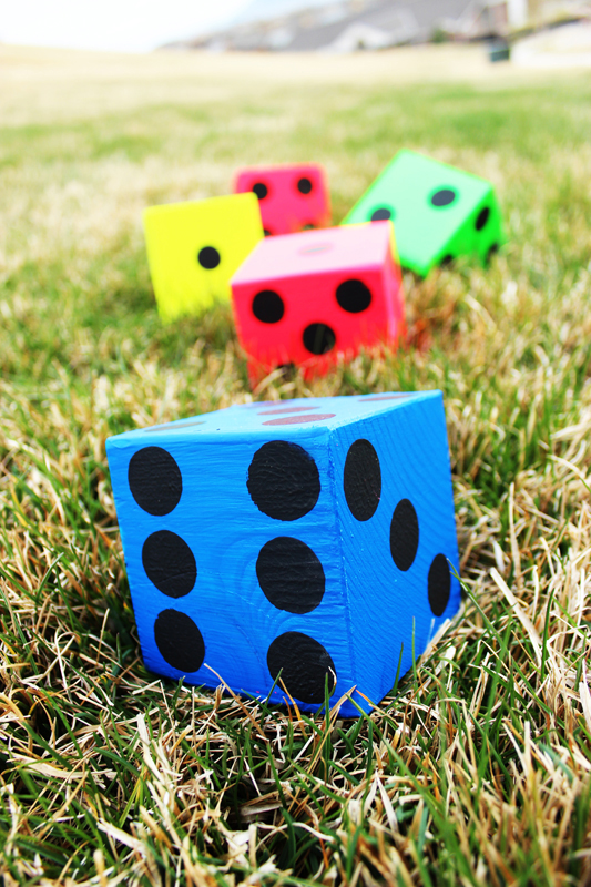 Giant brightly colored dice are perfect for an outside game of Yard Yahtzee | DIY