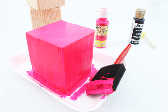 Use a foam brush to paint your wood blocks, making sure to cover them completely.