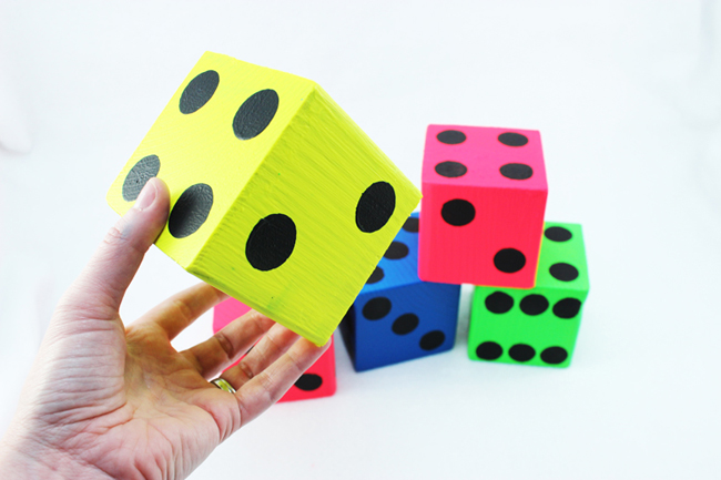 Make your own giant, brightly colored dice - perfect for yard yahtzee!