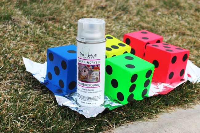 Seal your yard yahtzee dice with an acrylic spray - this will protect your color and make them shiny.