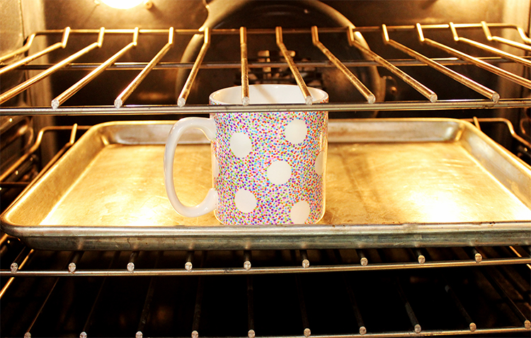 Put your DIY Sharpie mug in the oven to set the design. Allow it to cure for three days!