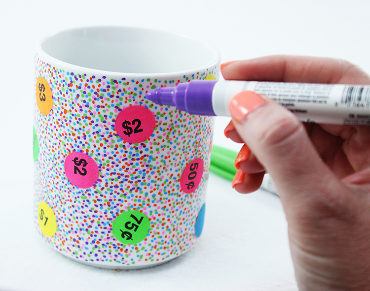 Use your oil-based Sharpie pens to make dots all over your mug!