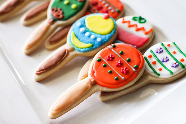 Maraca cookies are super easy to decorate. A great Cinco De Mayo party activity for kids!