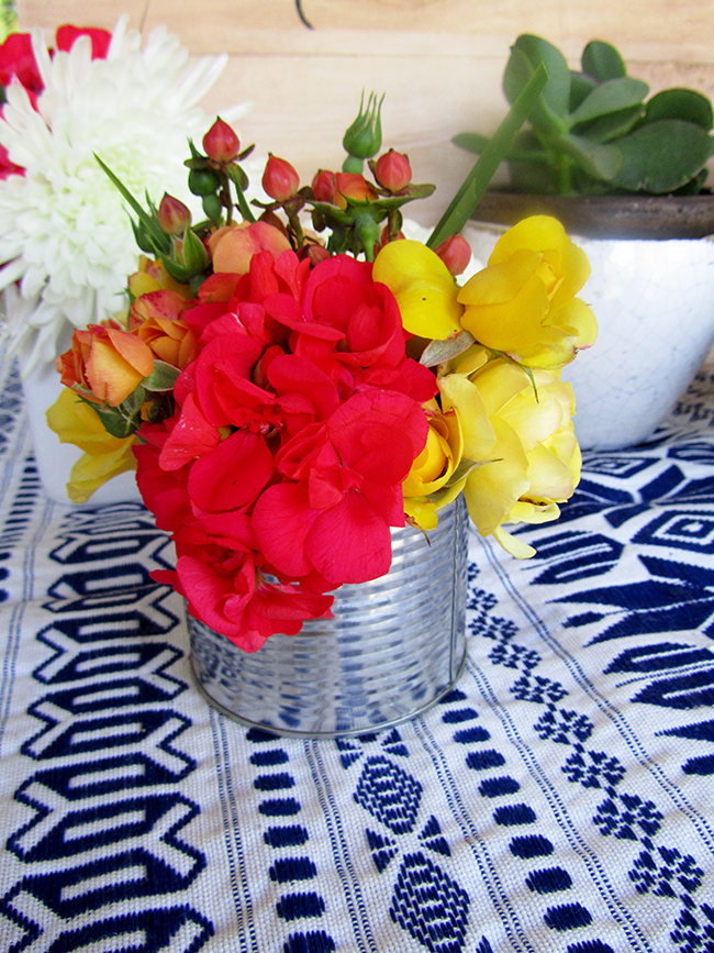 Old Tin Cans are a great way to display flowers for a charming, rustic look at your next party.
