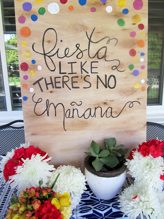 Use an old piece of wood to make a fun sign for your party.