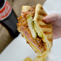 Cubano Sandwich - This sumptuous grilled sandwich—a crusty roll filled with roast pork, ham, Swiss cheese, and pickles— made famous in the movie Chef.