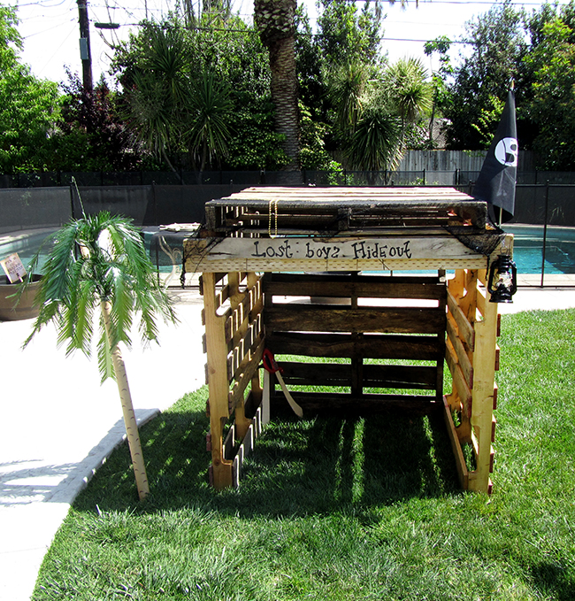 Bring a touch of Neverland to your next pirate party with a Lost Boy's Hideout. This is a simple DIY project you can make with old pallets.
