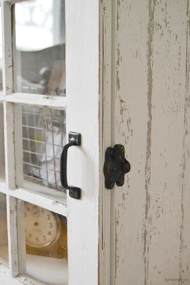 The window lock makes a great latch for this repurposed, shabby chic cabinet.