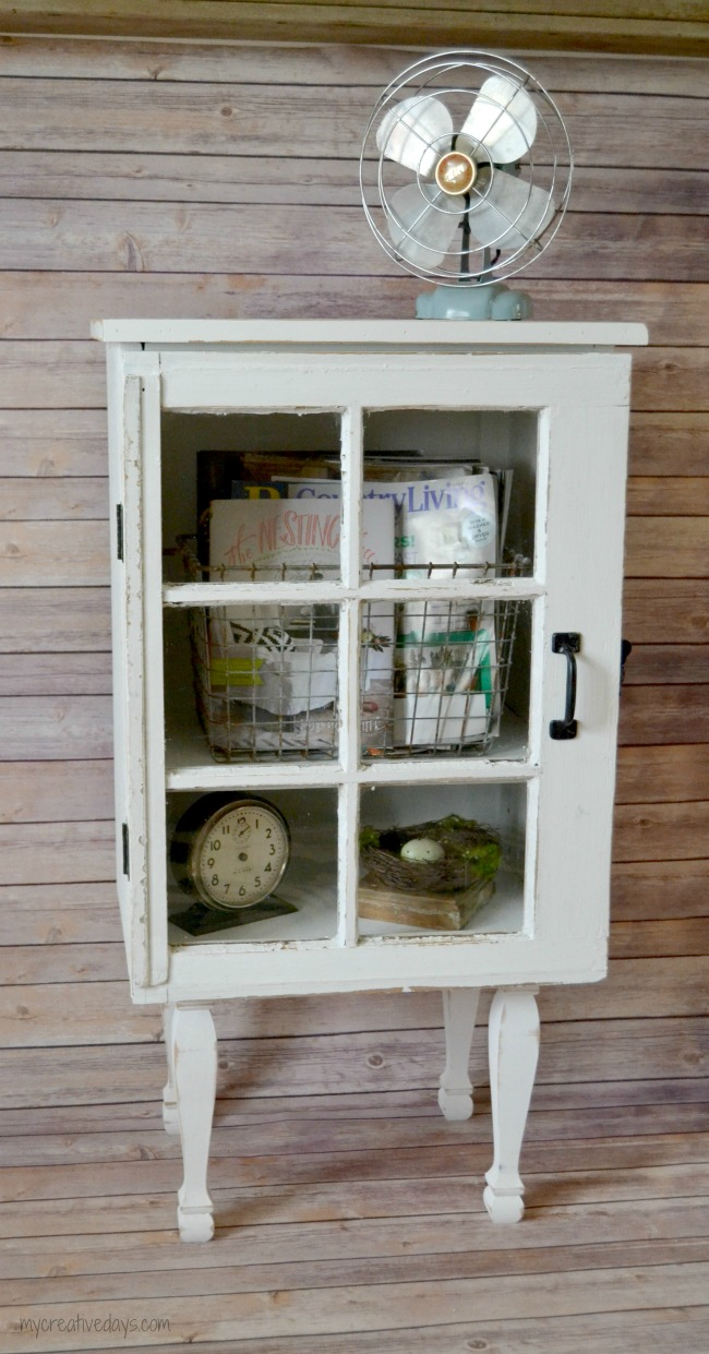 Inspired by a cabinet at Target, this shabby chic window cabinet is the perfect touch to any room.