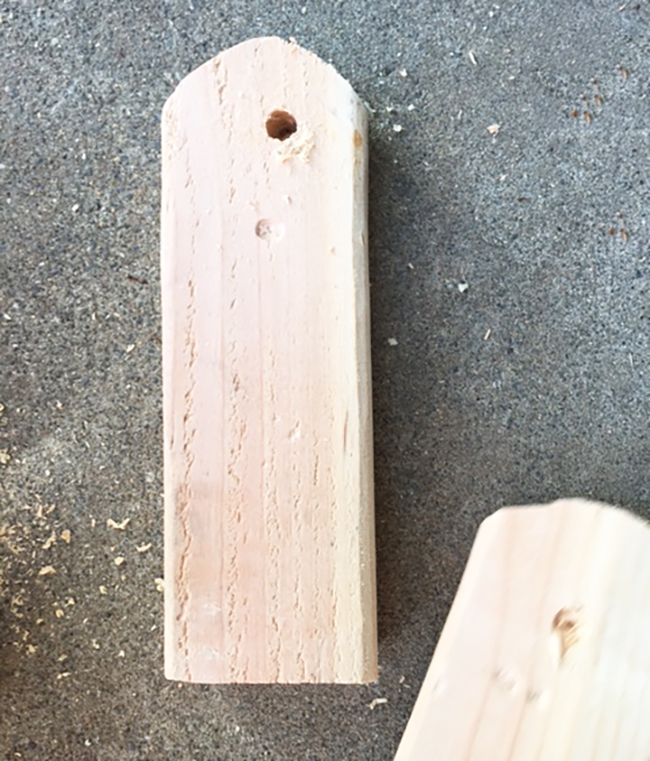 Round the corner of the legs and drill a hole.