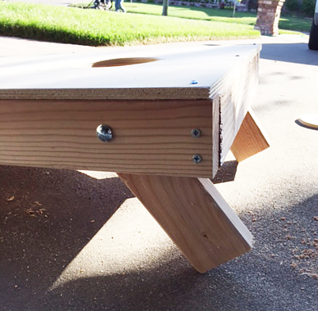 Attach the legs of your corn hole board with a carriage bolt.
