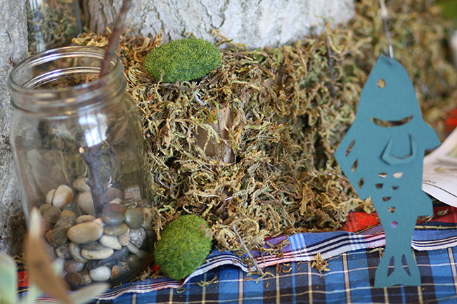 Add rocks to your mason jar, and use a twig to attach your twine and fish - and you have a fishing pole that is just right for a centerpiece.
