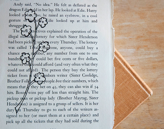 Draw your picture directly on the book page. Start with light pencil lines and then darken them as you get the perfect image.