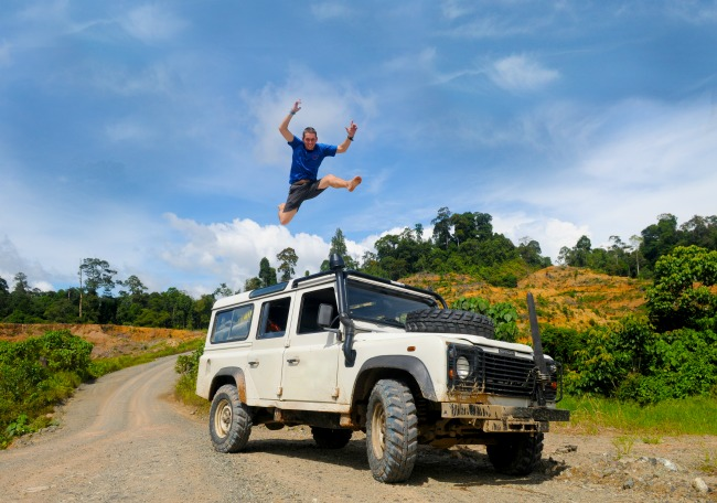Super excited! Man jumping on top of 4x4