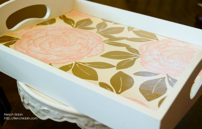 This white cottage serving tray used to be plain wood. With a little paint, old wrapping paper, and some mod podge,, and you have a beautiful new tray.