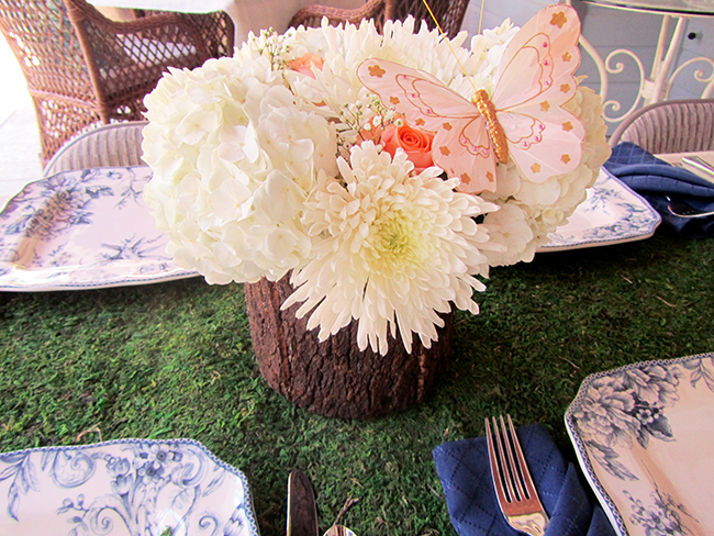 Bring the outdoors in by using a moss table runner and putting your flowers in a wooden vase.