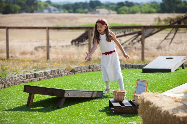 Corn Hole is a the perfect game for a backyard party. Kids and adults will have fun playing. You can make your own corn hole board inexpensively.