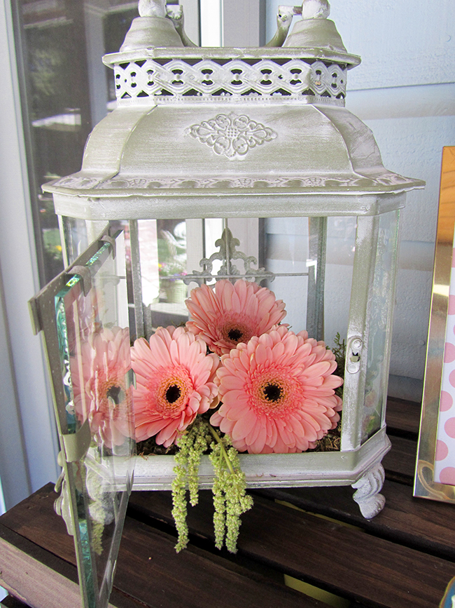 Love this lantern full of flowers for a wedding shower decoration. Super cute.
