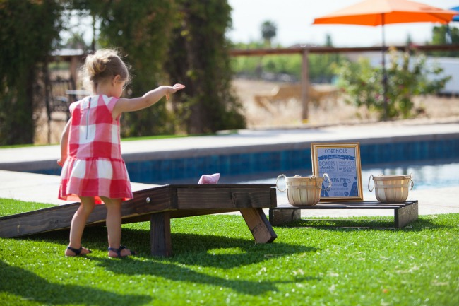 Corn Hole is a great game for a backyard party. Get a free printable rules card and easy tutorial for making your own corn hole boards.